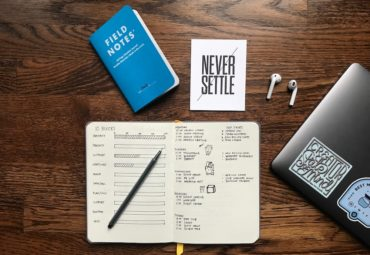 desk and books showing productivity notes