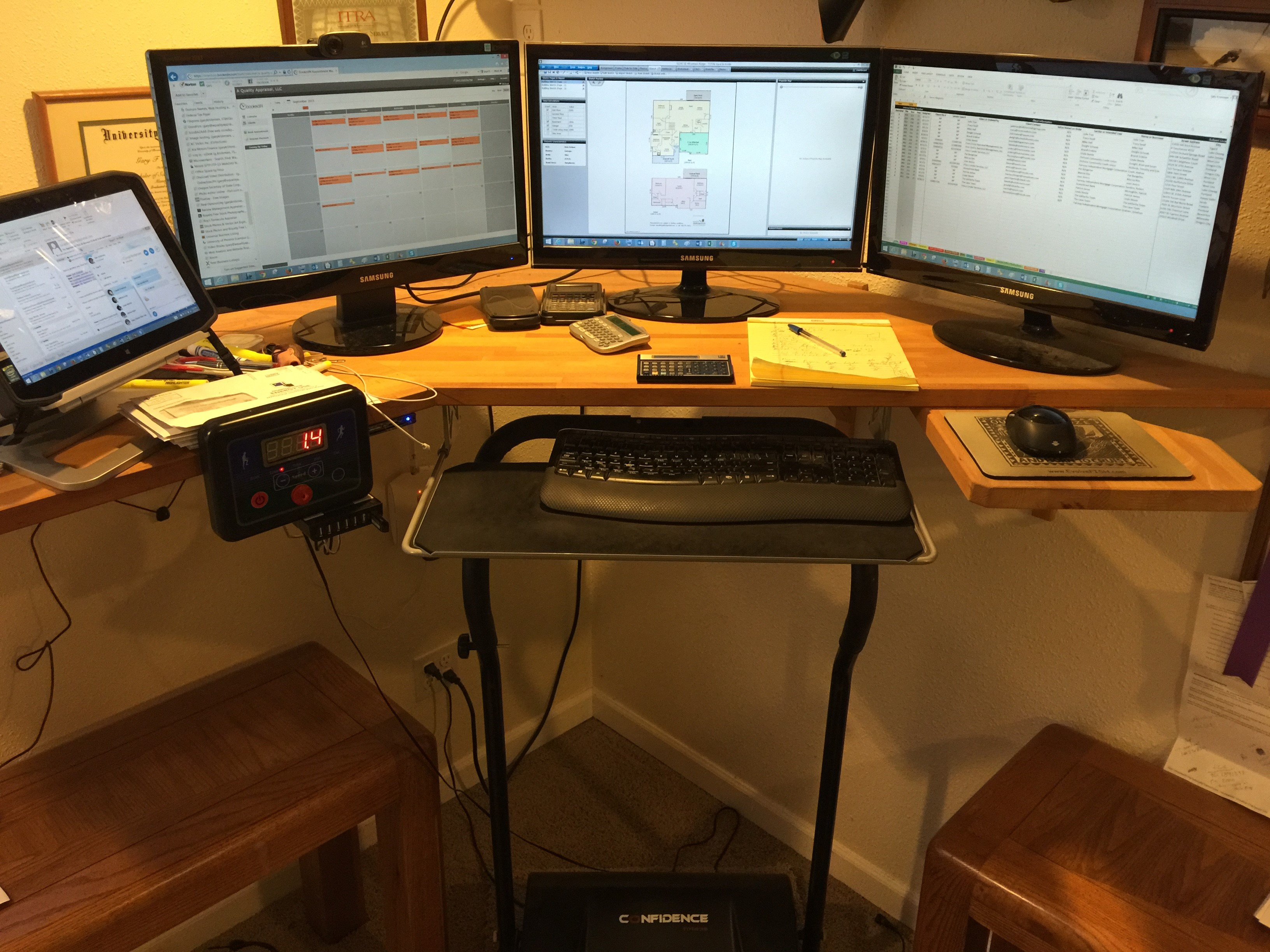 Gary's standing/treadmill desk with a full monitor dedicated to BookedIN!