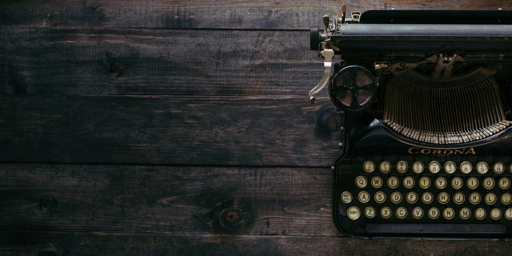 typewriter for business blog on wooden floor