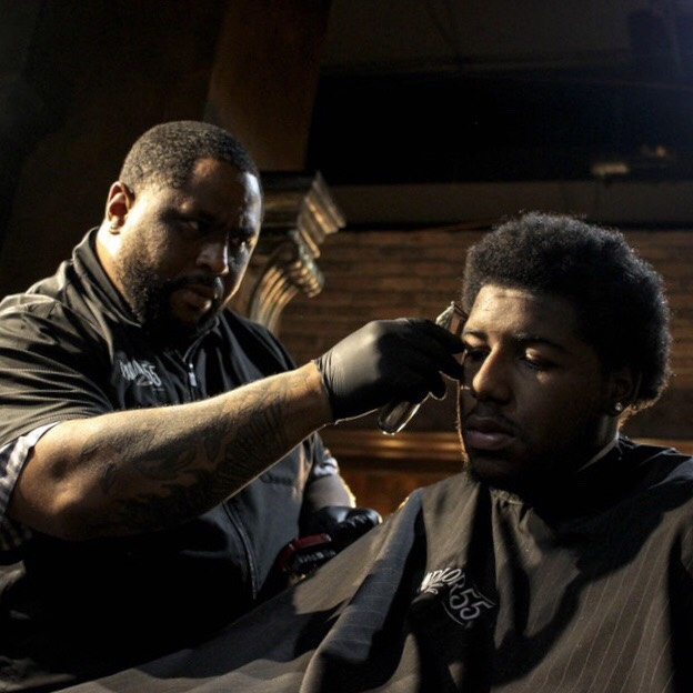 barbershop owner giving a fade
