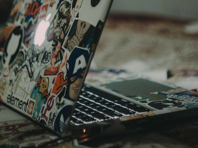 open business laptop that is covered in stickers
