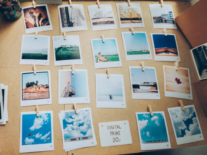 polaroids sitting on a desk