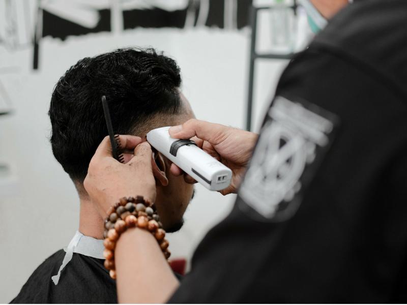 man getting a hair cut at his salon appointment