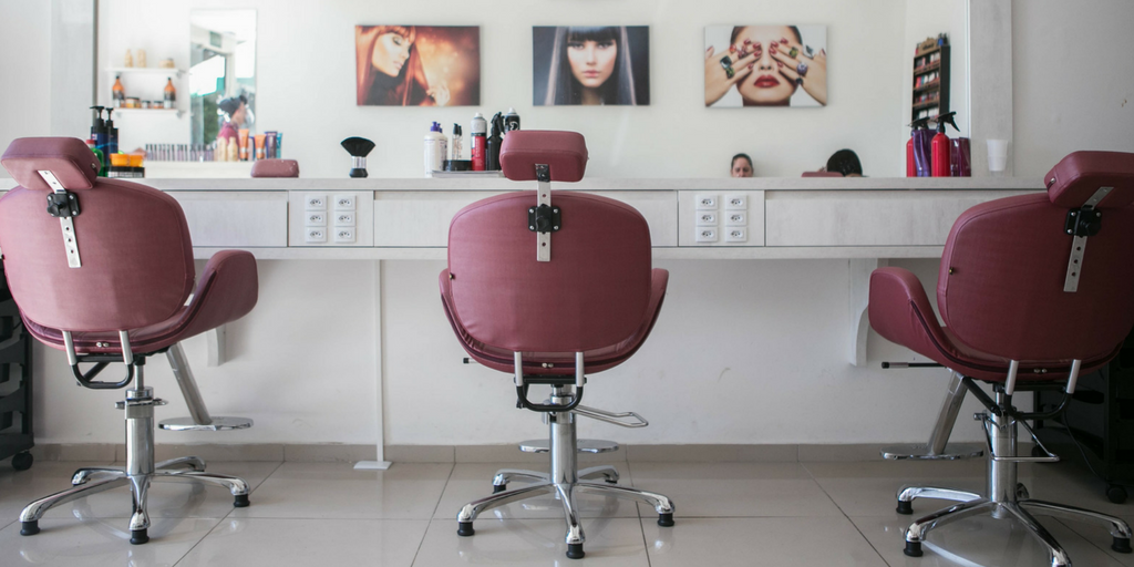 salon setup with chairs and mirror