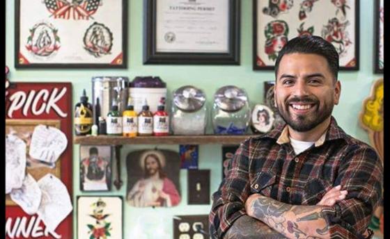 Edgar Guardiola tattoo artist in shop