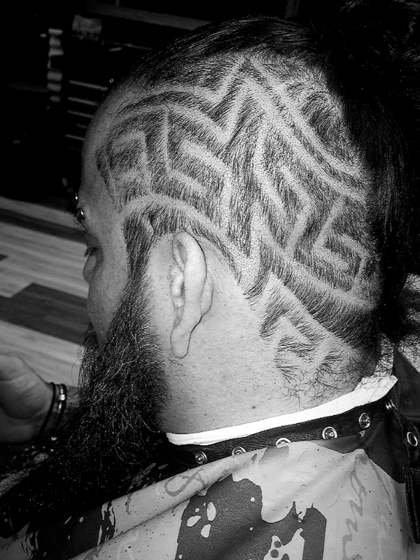 man with intricate design shaved in his head