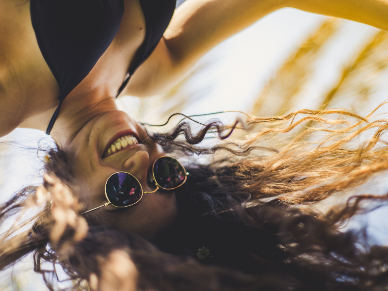 woman upside down and laughing