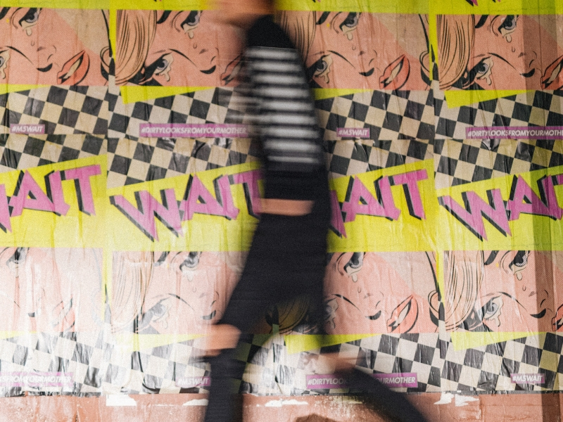 graphic wall with blurred man in foreground