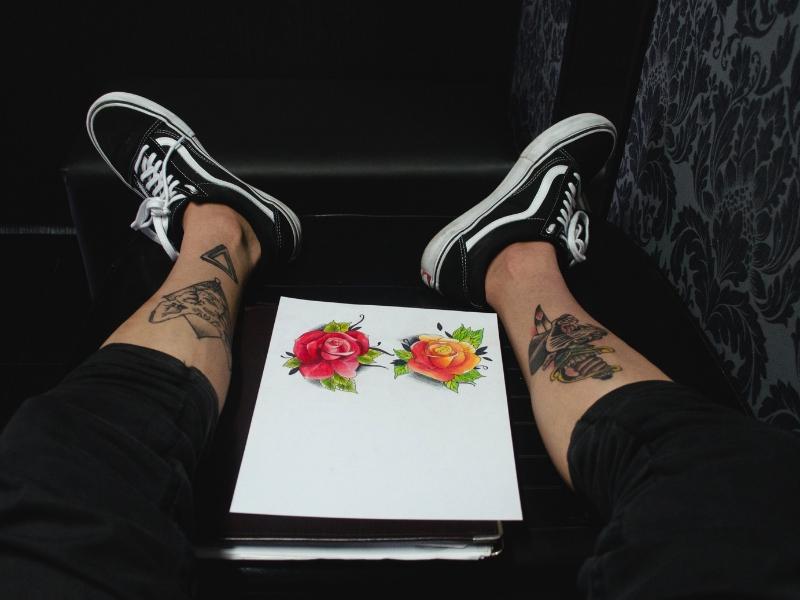 a tattoo artist shows his work