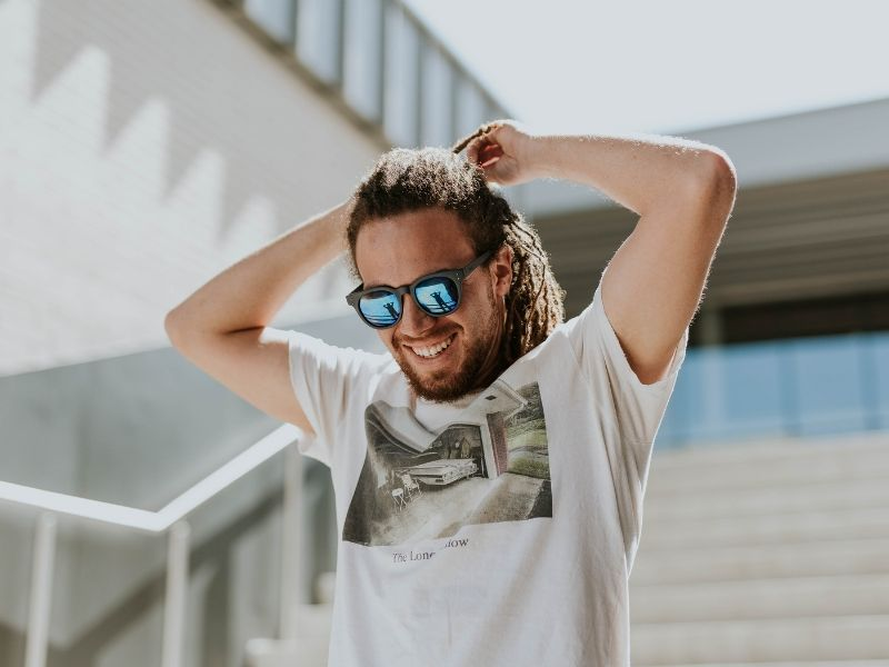 a man on a staircase wearing sunglasses