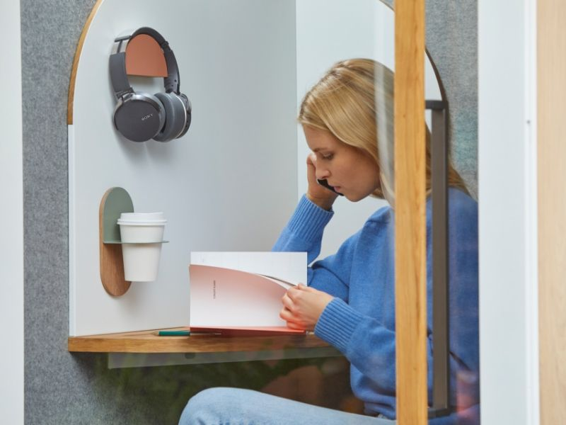 a woman sitting in a booth with boundaries