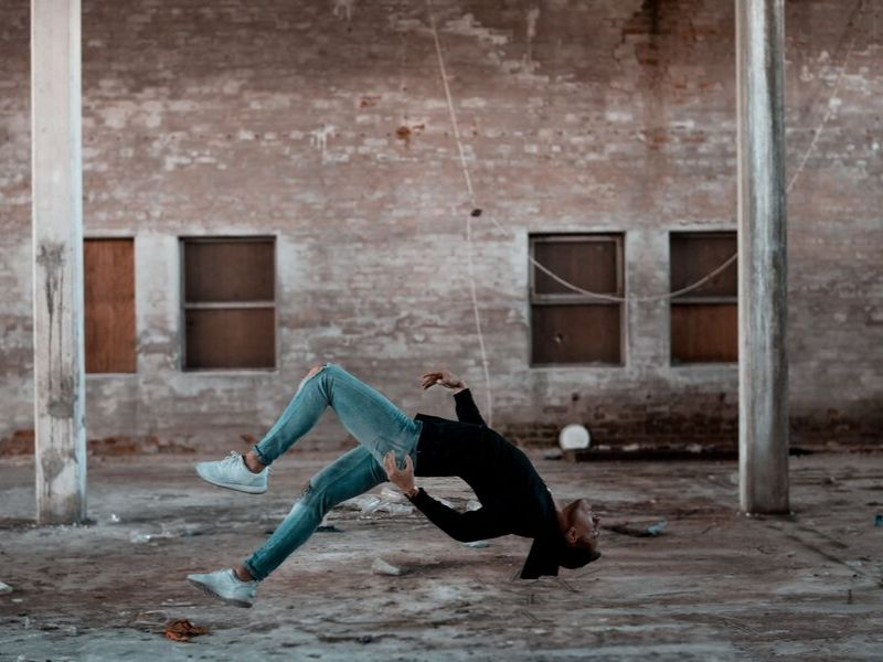 woman is doing tricks falling backwards