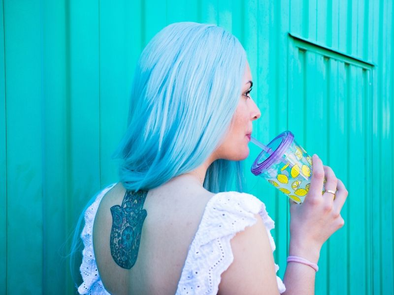 female creative business owner with blue hair