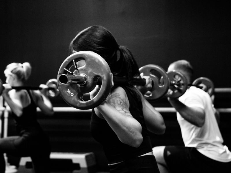 people personal training with barbells