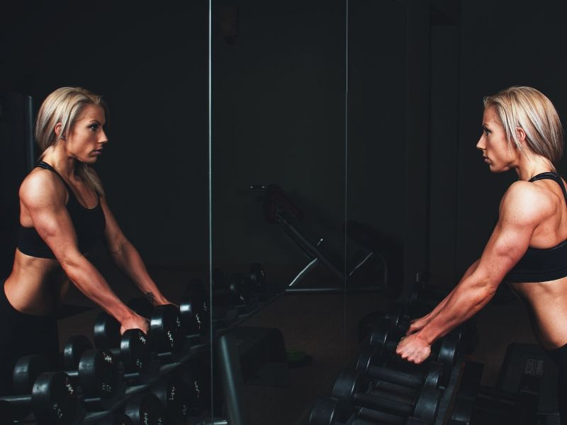 personal trainer with barbells