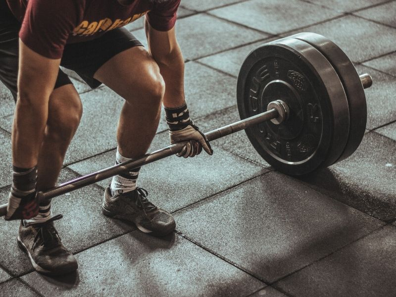a man lifting a barbell