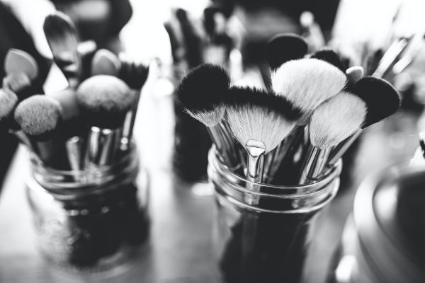 makeup brushes in containers
